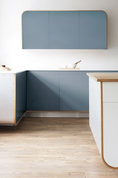 This light and spacious Air Kitchen by deVOL features a large island with a limed oak worktop.