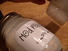 Mod Podge in a Pint Jar (matte)  Fill jar half way up with white glue (like Elmers)  Then fill jar up with water.  Shake Well.  This is a 50-50 mixture glue/water.   It will have a Matte finnish.   If you would like a Glossy finnish, add 1 TBS of clear varnish.  Shake it!