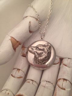A personal favorite from my Etsy shop https://www.etsy.com/listing/267427252/wolf-locket-teen-wolf-silver-tone-locket