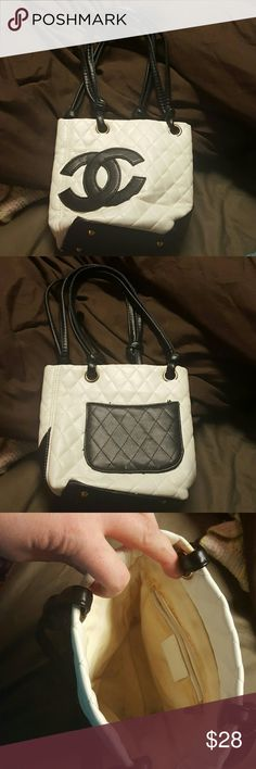 Small hand bag Used but in good condition. The inside liner is a little dirty from use but it's still in good condition. Back has a small pocket. Straps not adjustable. Last picture to show size of purse Bags Mini Bags