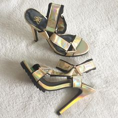 "Holographic strappy shoes Brand new in box. Tell your other heels to take a hike. Holographic gold straps with adjustable velcro detail at front. Treaded sole, stiletto heel.  *Shoe height: 8""/20cm  *Heel height: 5""/12.5cm  *Platform height: 1""/2.5cm.                                  **Join Poshmark app with my code HPYGO and get $10 to spend!** YRU Shoes Heels"