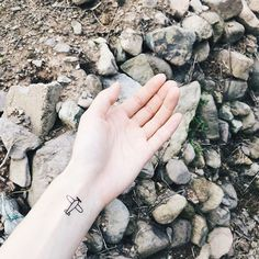 Escaoe Plan - small plane tattoo on wrist for girl