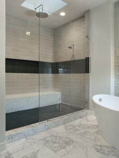 LOVE the set-in shelf that runs the length of this shower, and the length-wise bench