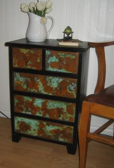 This one of a kind, upcycled authentic Mexican Pine Nightstand/Cabinet has been treated to a new look with a soft black chalk painted base and a light distressing. Finished in dark stain for a richer color and durability. I've given the drawers a unique verdigris and rust patina finish. A truly wonderful treatment that gives the look of old rusted metal. Comes complete with it's original metal drawer pulls which I have also treated to the rust finish...