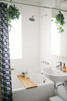 Serene bath, no fuss, no muss. Shower curtain by John Robshaw, bath board by Marvin Freitas. via design*sponge.
