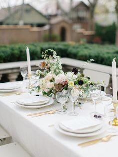If you have an organic wedding style, then look no further than this natural wedding inspiration! Taking nods from the European countryside, this tablescape on a terrace features foraged garden blooms, Parisian folding chairs and soft linens. Just wait till you see her chantilly lace sheath wedding dress and cherry blossom bedecked cake! #ruffledblog