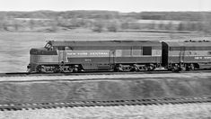"""NYC, Fairborn, Ohio, 1956 Northbound New York Central train led by 1947 Fairbanks-Morse """"Erie-built"""" no. 5003 leaves Fairborn, Ohio, in the summer of 1956. Photograph by J. Parker Lamb"""