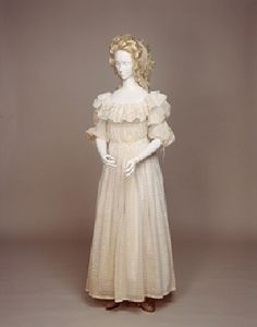 """Here we have a """"chemise a la reine"""" made famous by Marie Antoinette who caused a scandal by being painted wearing a simple white muslin dress. Poor Marie :-(.   This was popular in the 1780s and was often worn with a colored silk sash."""