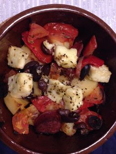Oven cooked mix of: potatoes, onion, tomatoes, kranski sausage, capsicum, feta & olives, seasoning: oregano. Mmmyammm ;D