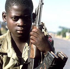 This shows disorder because one main reason. In this photo the child does not look one bit happy. He is holding a gun which makes me think he is a child soldier. In Africa they should not be forcing children to grow up like this. This is disorder because many people want it to stop but it won't.