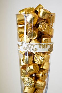 Great centerpiece idea for a 50th anniversary party - fill a glass or jar with golden candy