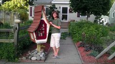 """Shannon Gardner. St. Paul, MN. My wife Shannon is a book editor and asked that I build a Little Free Library for our small house and garden here on the east side of St. Paul. The library style is a bit """"Seussical."""" There do not seem to be as many of these libraries in our vicinity as other places in the Twin Cities--I wasn't convinced that it would get much traffic. However--it has been up for less than a week and already we are getting low on kids' books!"""