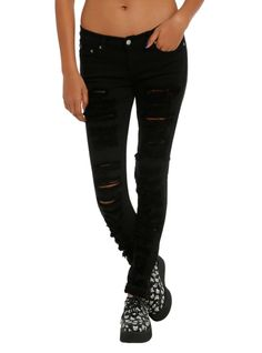 Black skinny jeans from Judy Blue with ripped accents, 5-pocket styling and button and zip fly.