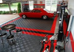 RaceDeck garage flooring makes for one cool #racedeck #garagefloors #garagefloortiles #coolestgarageontheblock #racedeckspeedgarage #mygaragemakesmehappy #coolgarages  http://www.racedeck.com