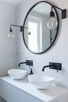 Bathroom, marble tiles, marble, black and white bathroom, industrial luxe, industrial bathroom, black taps, black fittings, resin sink, black mirror, round mirror, black wall lights, double sink, black sink taps