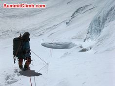 Sherpa pulling fixed line above fresh snow on North Col - Photo Mia Graeffe.