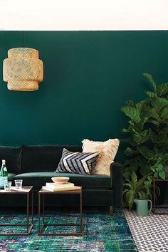 opulent green and gold living room carpet and tables
