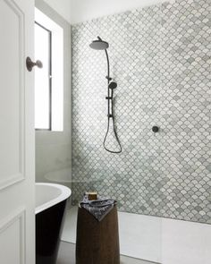 Moroccan fish scale tile, or mermaid scale tile is a decor trend we are totally obsessed with right now—from bathroom showers to kitchen backsplashes, this mosaic tile is taking over Pinterest.