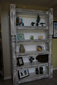 I took old porch post, old shutters and made this book shelf!