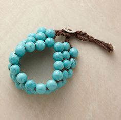 """Defy tradition with Chan Luu's unusual woven bracelet, handcrafted of smooth, exquisitely matrixed turquoise beads and soft cotton cord. 7-1/2""""L."""