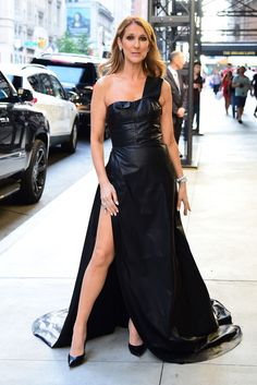 Celine DIon in this dramatic one-shoulder, high-slit black leather gown truly left an impression.
