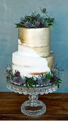 Semi naked & thistles tiered wedding cake with metallic gold overlay.