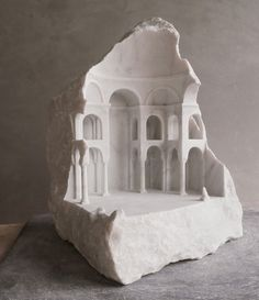 Miniature Architectural Spaces Nestle into Carved Chunks of Raw Marble