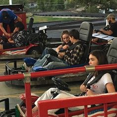 Maya & Josh at a theme park riding bumper cars<<hate to say it but I'm pretty sure that thats Maya and Farkle