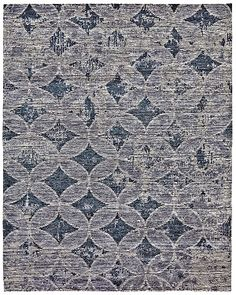 Finley 7224F in AzureThe Finley Collection combines the lavish look of bamboo silk with rich and varied shades of hand spun wool to create sumptuous trompe-l'oiel and distressed designs.  Transitional and contemporary in style, the velvety pile of each rug is punctuated by simple, timeless designs Tibetan hand knotted in a palette of soothing, on-trend colors.