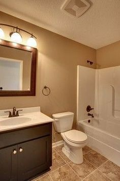brown tile bathroom paint. behr kilim beige  Google Search Kids Bathroom PaintKid I like this blue but not the tile shows us how it works with
