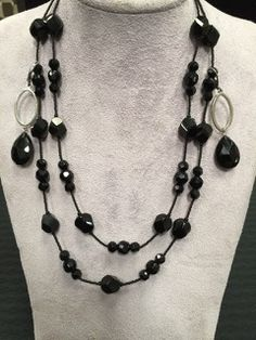 CONTEMPORARY TWO STRAND BLACK CRYSTAL NECKLACE AND MATCHING EARRINGS BY WHITE HOUSE BLACK MARKET. NECKLACE MEASURES 18 INCHES IN LENGTH.