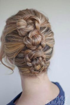 3 partial French braids each twisted into a bun. Have to try it out