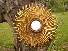 """Distressed glass and gilded pine. 17"""" across."""