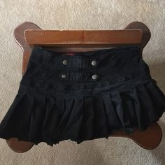 Gothic style  black pleated mini skirt Size Large TRIPP mini skirt.  Gothic style this skirt is SHORT!  It's very stretchy bought from Hot Topic.  Has a white stain from storage but will come out in the wash. Tripp nyc Skirts Mini
