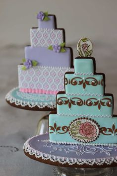 Close up of stenciled and needlepoint wedding cake cookies by Julia M. Usher