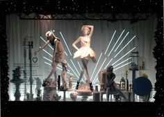 Selfridges window display. Love the lighting.
