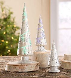 Color-Changing Silver Mercury Glass Christmas Trees, Set of 3 Wind & Weather® http://www.amazon.com/dp/B00OFYC5XW/ref=cm_sw_r_pi_dp_MlV.wb0N01ZTB
