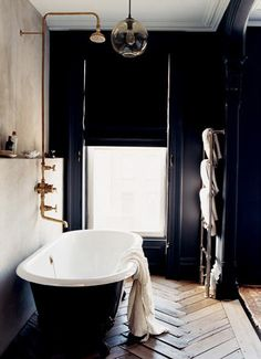 love the shower head. mike would love the black contrast tub. wood floors! if only they weren't so toe stubby.