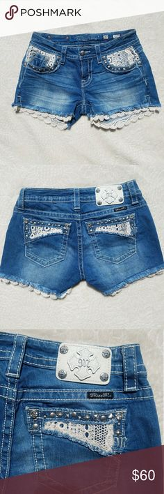 """Miss Me Signature Lace Trim Shorts Miss Me Signature Lace Trim Shorts 💙 *Zip fly with button closure  *5 pocket construction with lace detail  *Stud and rhinestone detail throughout   *Scalloped lace hem  -Approx. 8"""" rise, 4"""" inseam (size 27= 4)  Super cute for summer! Hot seller item!  In like new condition, never worn🌼 Miss Me Shorts Jean Shorts"""