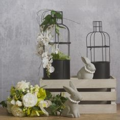 Urban garden DIY Easter project.  These urban metal bottle planters make a great display for floral arrangements. Its a perfect shape for hanging flowers and greenery.