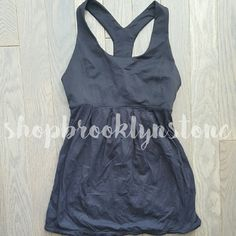 Lululemon Black Y BackTank Top Y- back style Lululemon tank with empire waist. Front and back pleats, shelf bra (padding not included), and drawstring at the hemline. Drawstring can be cinched to fit tight at the waist or hips. Looks new! lululemon athletica Tops Tank Tops