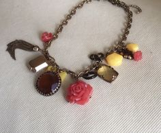 A personal favorite from my Etsy shop https://www.etsy.com/listing/229084363/charm-choker-necklace