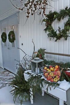 I would switch the apples for pine cones, but nice porch!