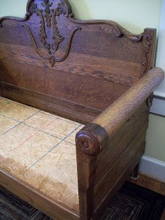 Antique bed is repurposed and used as a bench.