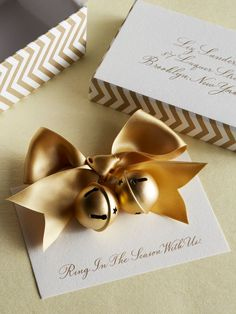place card idea with festive bells u0026 bow