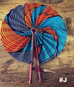 These colorful hand fans are our bestseller. Made out of leather and African print fabric they are a hot accessory for the Summer. Must have accessory! Hand Held Fan, Hand Fans, African Accessories, Interior Design Elements, African Fabric, Ankara Styles, Leather Handle, Fashion Prints, African Fashion