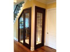 Under-the-stairs wine closet using Vigilant racking, doors and sidelights in this modern home in Philadelphia.