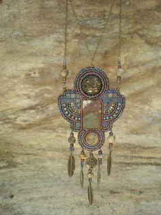 LIke the mix of the square beads and cab(?) looks more art nouveau than apache, however. Gorgeous work.