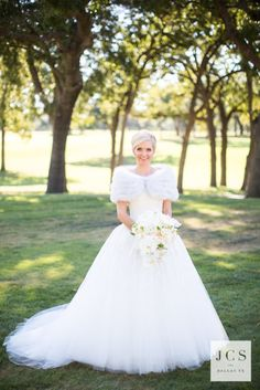 Custom gown by Patti Flowers! This bride had her mother's dress redone to fit her cute style!