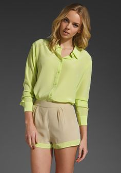 neon blouse & beige shorts with neon touch. cute look!